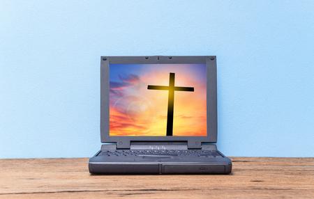 repentance: Cross on sunset in old laptop, Concept conceptual black cross, Gospel concept.