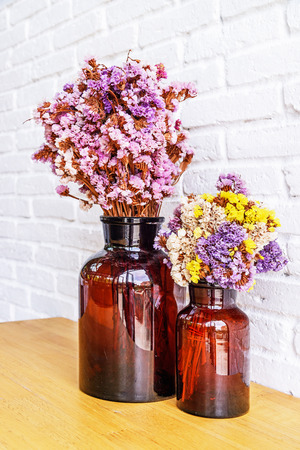 Dried flowers in bottle, Glass bottle is reused to decorate and dried flowers put inside. Selective focus.
