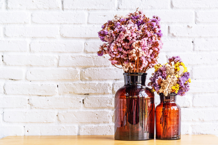 dried flowers: Dried flowers in bottle, Glass bottle is reused to decorate and dried flowers put inside. Selective focus.