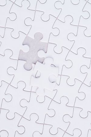 business puzzle: Missing jigsaw puzzle piece , Close up of the last jigsaw puzzle piece, Business concept for completing the final puzzle piece.