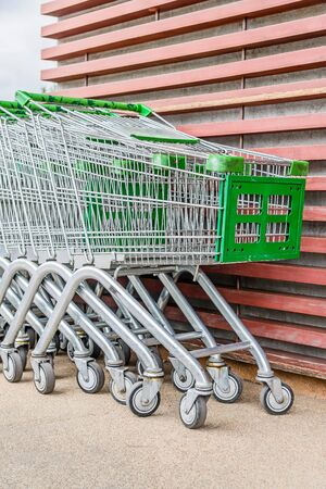carrefour market: shopping cart outside the shop