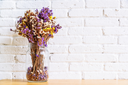 discarded: Dried flowers in bottle, Glass bottle is reused to decorate and dried flowers put inside. Selective focus.