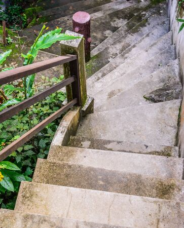 downwards: Stairs leading downwards to waterfall Stock Photo