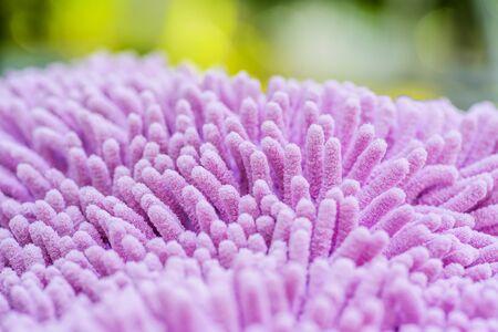 Close up of pink carpet softness texture, Carpet texture of doormat, selective focus. Stock Photo