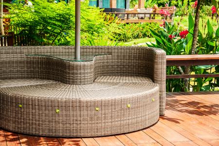 Modern furniture plastic wicker chairs in garden, Relaxing Rattan Sofa.