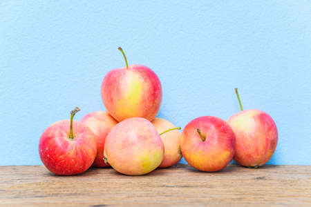 Fresh apples on wood background