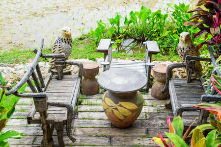 corner of house: Antique table and wooden bench outside corner house, Style of Thailand. Stock Photo