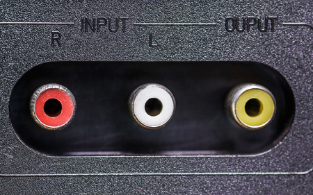 av: AV receiver and audio video input panel with signs,close-up shot, selective focus