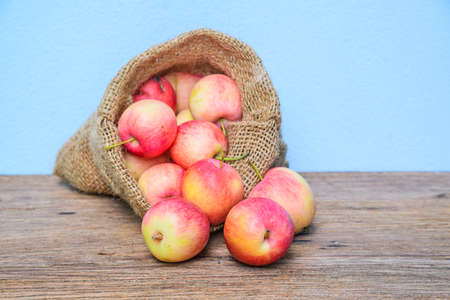 vitamin rich: Fresh apples with a cloth sack bag on wood table
