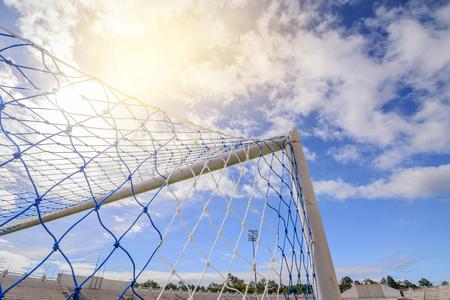 Soccer net on green grass in stadium