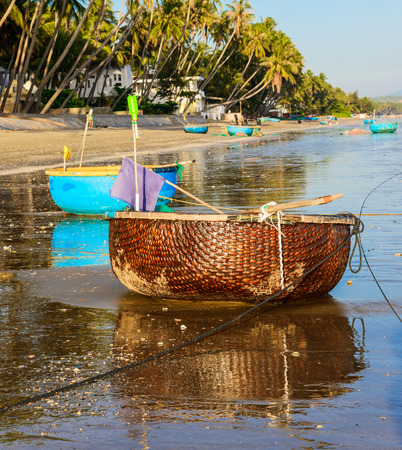 ne: Traditional Vietnamese fishing boat in the basket shaped, Mui Ne, Vietnam.