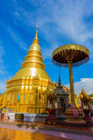 Wat Phra That Hariphunchai temple with colorful lanterns Festival in twilight, Lamphun or Lampoon province, Thailand.