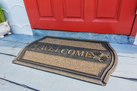 Welcome mat outside the front door Stok Fotoğraf - 69343944