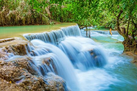 cascade: Amazing turquoise water of Kuang Si cascade waterfall. Luang Prabang, Laos. The famous attractions of Laos. Stock Photo