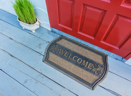 Welcome mat outside the front door Banco de Imagens - 69343977