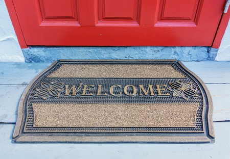Welcome mat outside the front door Stok Fotoğraf - 69343988