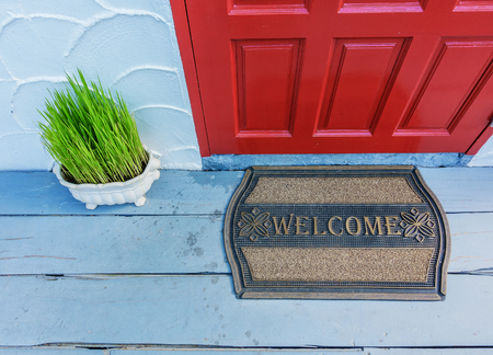 Welcome mat outside the front door Imagens - 69343989