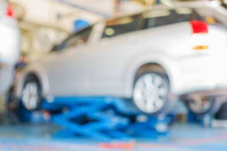 Blurred of car in in auto repair shop. Stock Photo