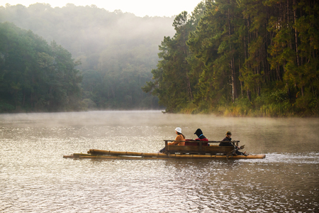 PANG UNG PARK, MAE SONG SON - DECEMBER 10, 2016:  Bamboo raft at Pang ung park in morning with fog on surface lake, Mae Hong Son ,Thailand in December 10, 2016.