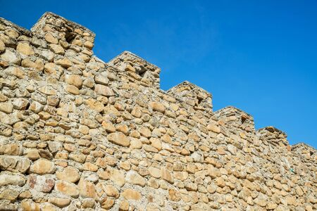stone wall on blue sky  background