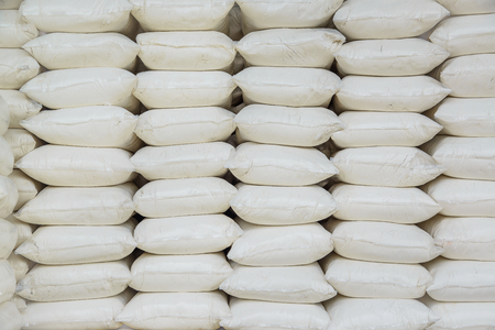 Pile of Calcium hydroxide or lime in bags, quicklime or slaked lime.