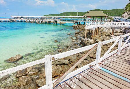 Wooden Bridge beside sea with beautiful seacape in koh lan island, Pattaya, Thailand.