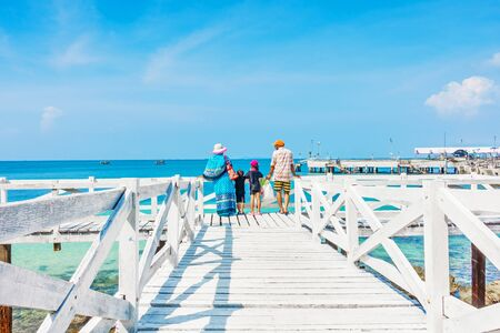 KOH LAN ISLAND, PATTAYA CITY, THAILAND - Oct 19, 2016 : Tourists family travel on wooden bridge at koh lan beach, Pattaya thailand Editorial