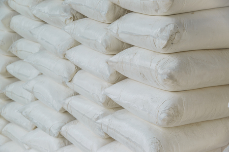 hydroxide: Pile of Calcium hydroxide or lime in bags, quicklime or slaked lime.