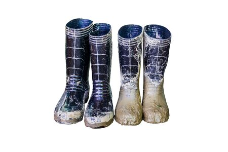 Muddy rubber boots on white background, with Clipping Path.