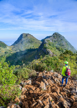 CHIANG MAI, THAILAND : January 21, 2017. Man on the top of the hill watching wonderful scenery in amazing  mountains in Chiang Daio, Chiang Mai, Thailand.