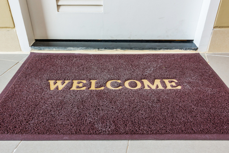 Stock Photo   Welcome Carpet, Welcome Doormat Carpet On Front Door.