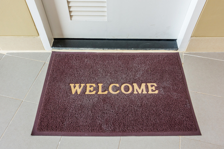 Welcome carpet, welcome doormat carpet on front door.