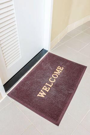 furnishings: Welcome carpet, welcome doormat carpet on front door.  Stock Photo