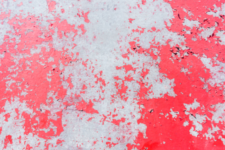 Old Red Peeled covered with old enamel with a cracks.  Renovation Concept. Grunge background - wall covered with cracked paint Stock Photo