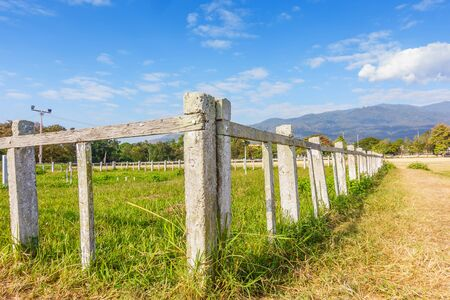 Cement white fence , white fence in farm field
