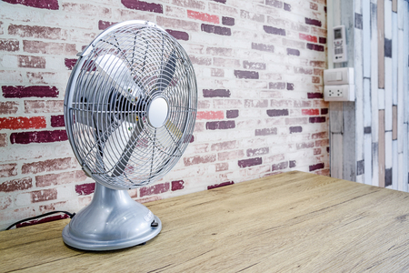 metalic: Vintage silver electric fan on the table Stock Photo