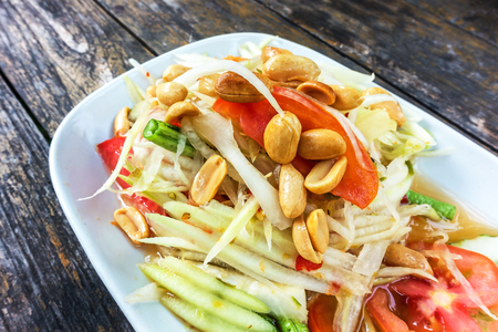 Thai Papaya salad. Traditional spicy Thai food name somtum.