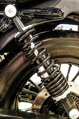 damper: Close Up of Motorcycle Superbike Shock Absorber and Spring