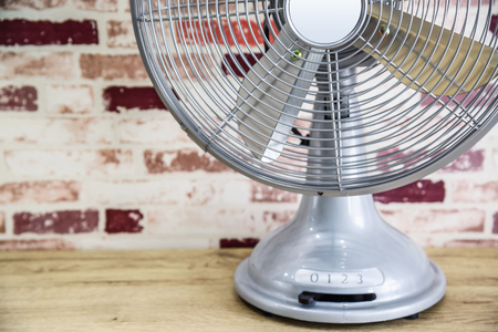 Vintage silver electric fan on the table Stock Photo
