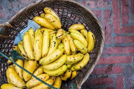 Bunch of bananas in basket at luang prabang market, laos.