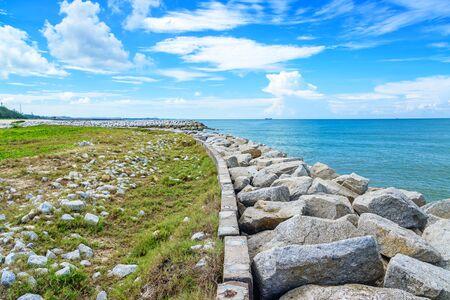 Stone wave breaker into the sea