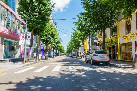 SEOUL, SOUTH KOREA - May 26, 2017: Garosu-gil Street Sign, Garosugil is a trendy tree-lined street with plenty of cafes, bars, restaurants, shops and art. Hugely popular with fashion aficionados and even celebrities. Editoriali