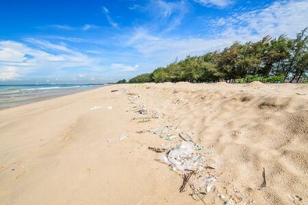 Pollution on the beach of tropical sea. Stock Photo