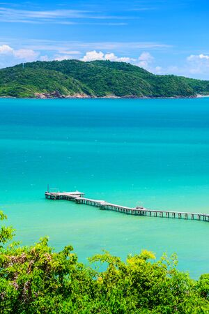 The wooden bridge stretches into the sea, pier beach in Rayong, Thailand