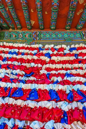 26: SEOUL, SOUTH KOREA - MAY 26 2017: Colorful pattern of blue and red cloth pockets at Bongeunsa Temple, Seoul City, South Korea. Editorial