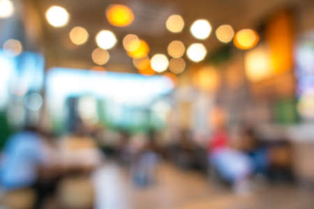 round chairs: Blurred background : Customer in Coffee shop blur background with bokeh. Stock Photo
