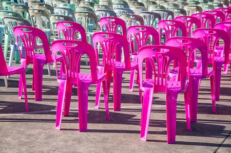 Vacant empty plastic chairs pattern