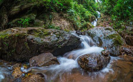 Deep forest waterfall at Doi Hua Mae Kham Waterfall in Chiang Rai, Thailand. Stock Photo