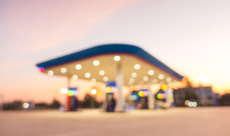 Out of focus twilight gas station, Abstract blurred of gas station in twilight. Stock Photo