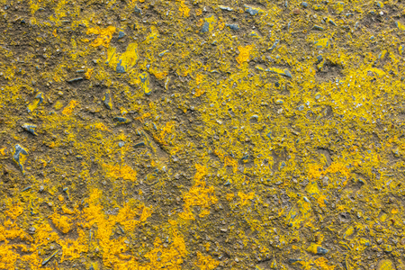 Vivid yellow painted rough concrete wall or floor texture background Stock Photo